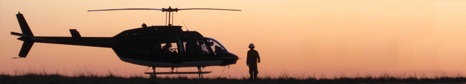 helicopter silhouette at dusk